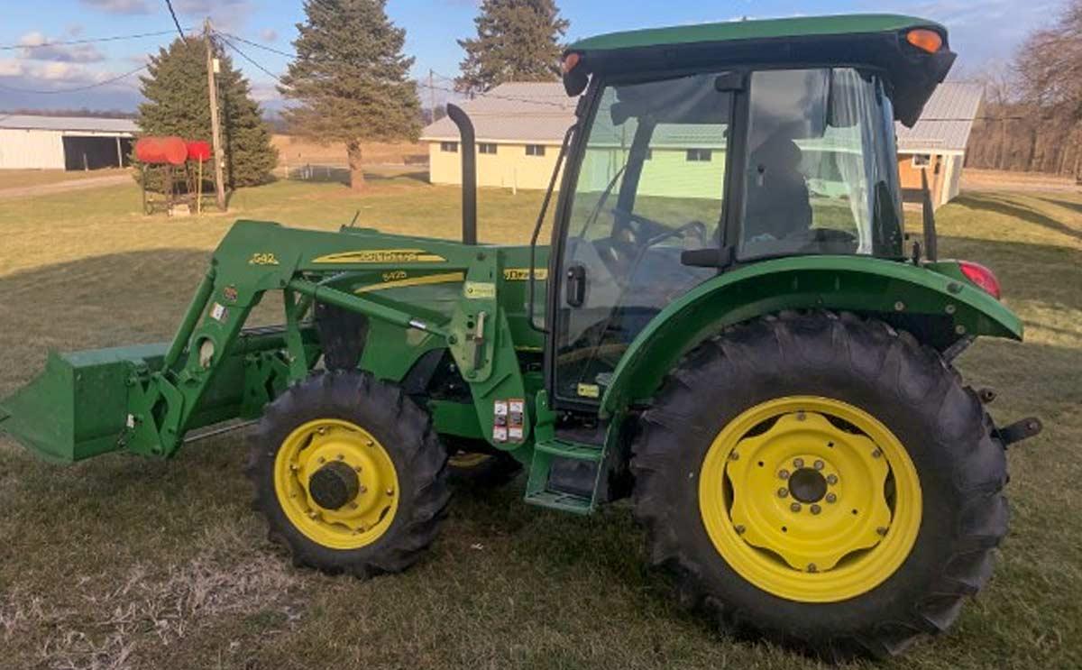John Deere Tractor at the Mahlon Dunkel Farm Land & Equipment Auction